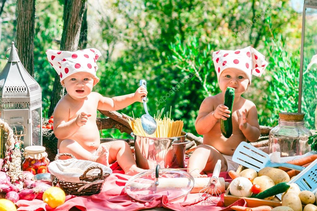 Happy children cook. Funny kids playing outdoors. Summer vacation concept