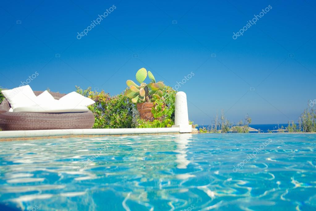 luxury infinity swimming pool with sea view
