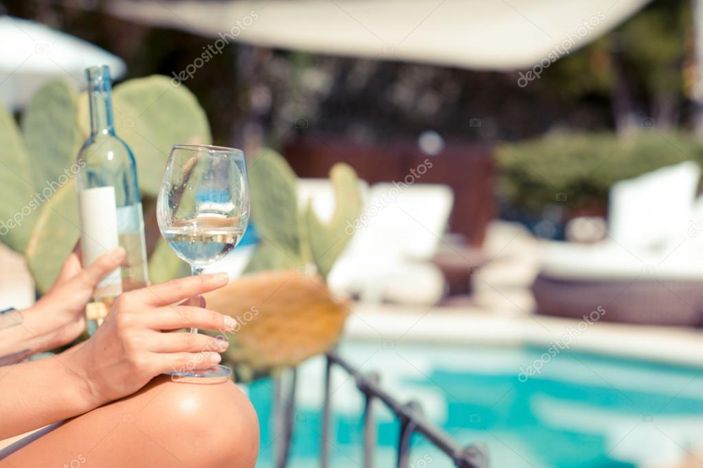 Female hand holding a glass with wine