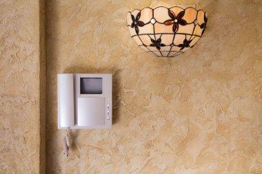 Wall with  video intercom equipment