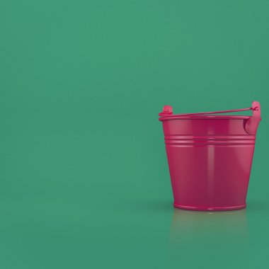 Red bucket on a green background  front view with space for text