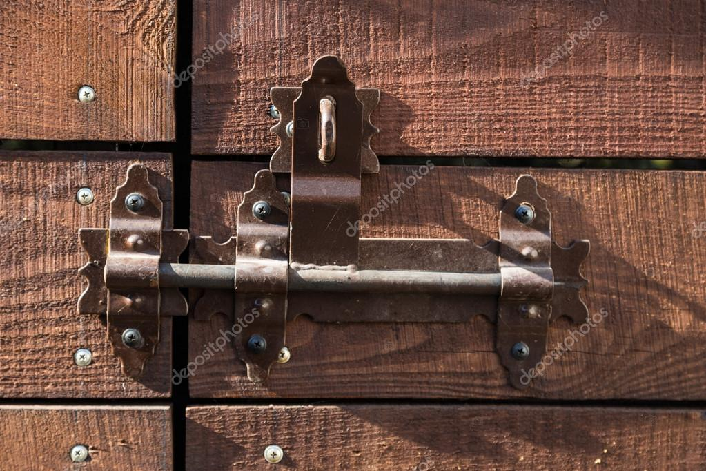 Door with deadbolt for closure in the rays of light