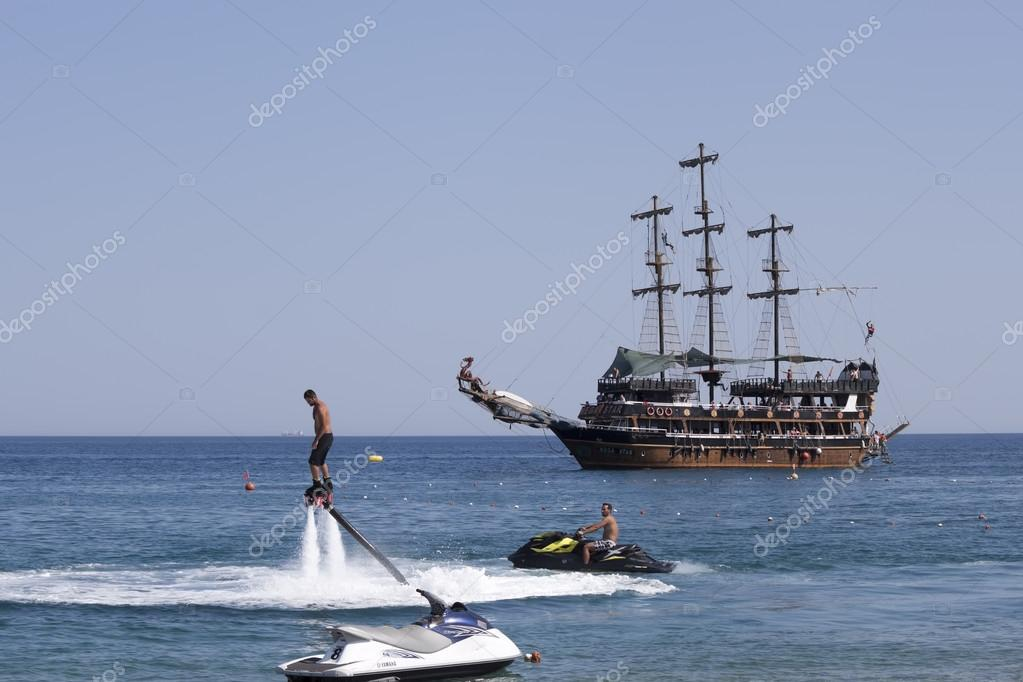 flyboard and yachting stylized pirate schooner – Stock Editorial