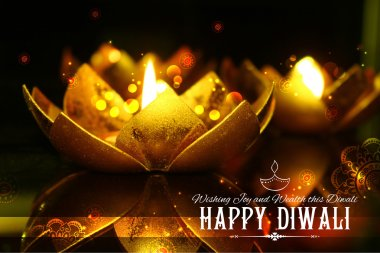 Golden lotus shaped diya on abstract Diwali background