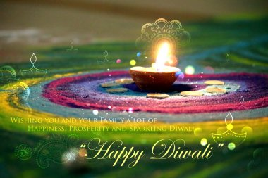 Diwali diya on colorful rangoli