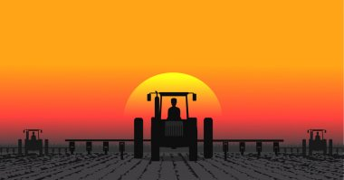 Tractor processes the earth a rural landscape