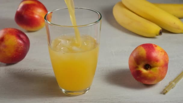 Pouring delicious raw fruit juice In Glass.