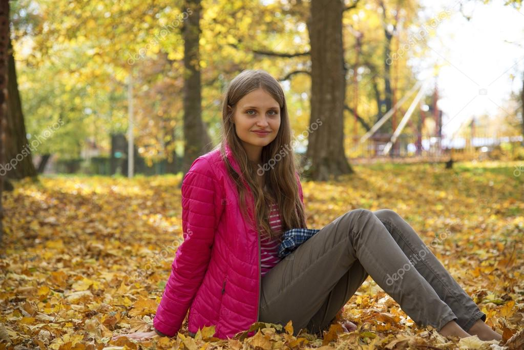The young girl in autumn park