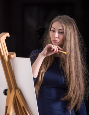 Woman and easel