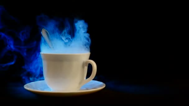 Cup of hot beverage with steam.