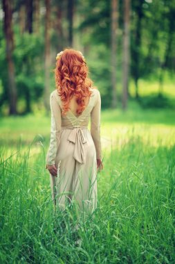 Gentle woman in the forest