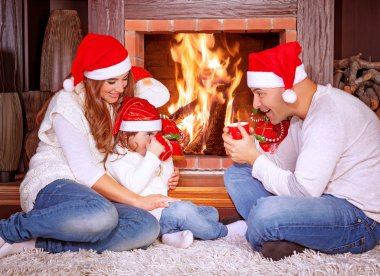Happy family by fireplace