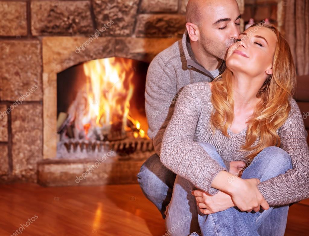 Loving couple near fireplace — Stock Photo © Anna_Om #61040587
