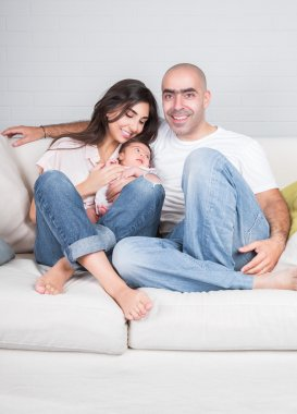 Happy parents with little baby
