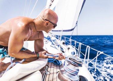 Handsome man on sailboat