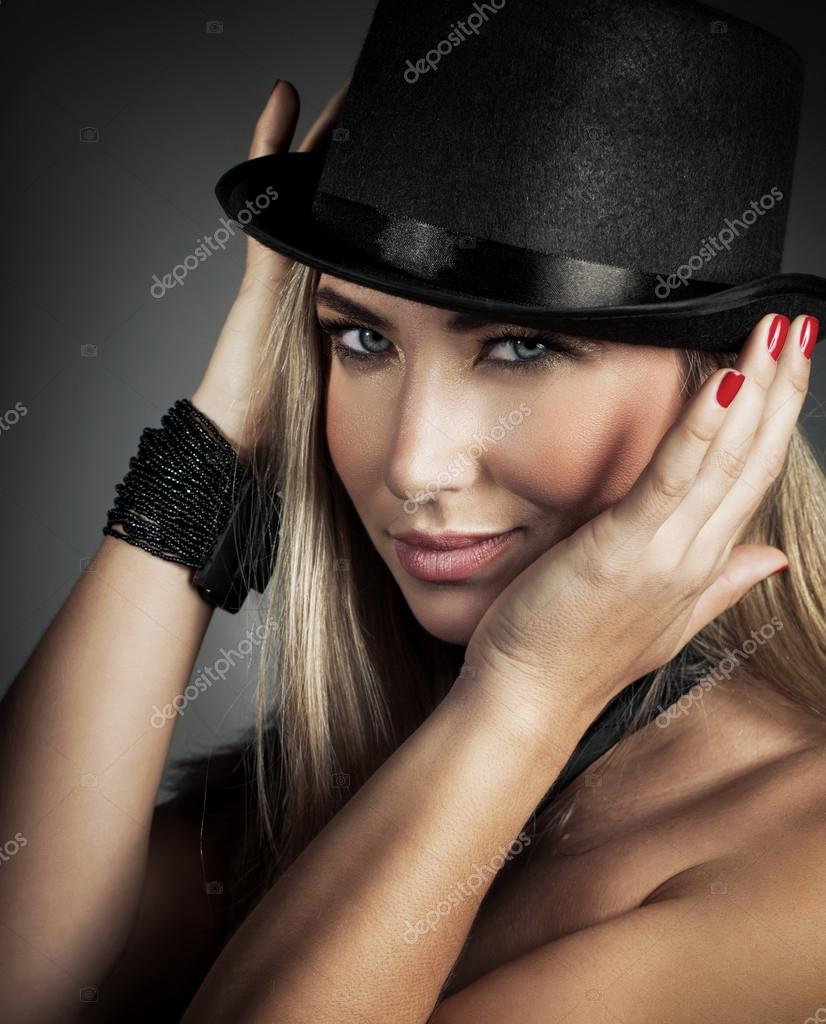 Closeup portrait of beautiful blond female with perfect makeup wearing  stylish hat and bracelet posing over gray background ef43addbbeba