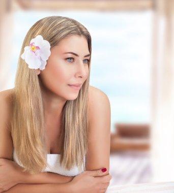 Gentle woman on spa resort