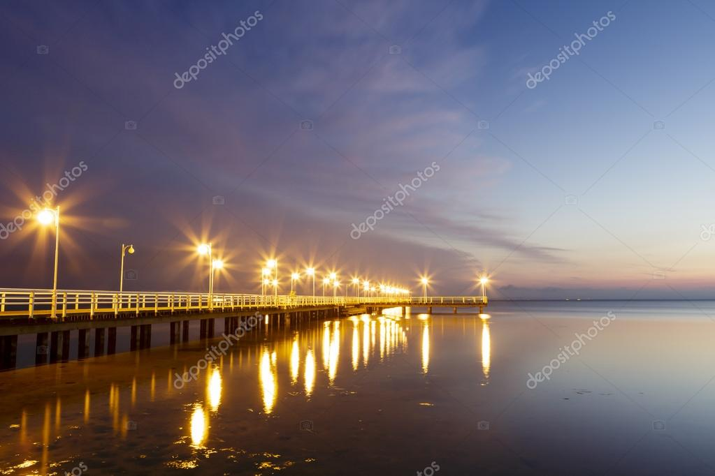 Wooden pier in Jurata at night, Poland