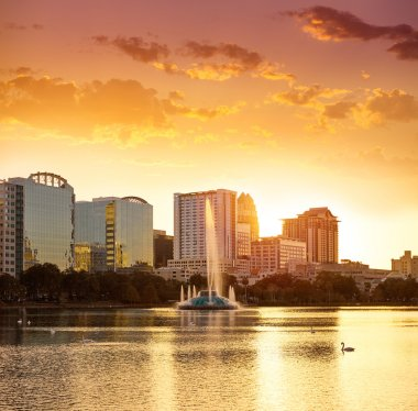 Orlando skyline sunset at lake Eola Florida US