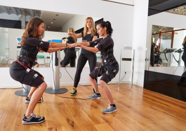 EMS electro stimulation women exercises