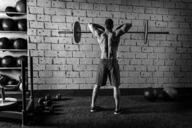 Barbell weight lifting man rear view workout gym