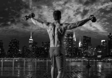 gym man rising hex dumbbells in New York city