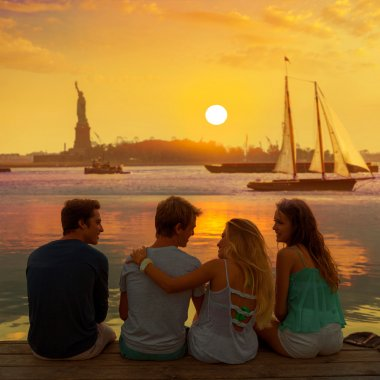 Friends group rear view at sunset fun New York