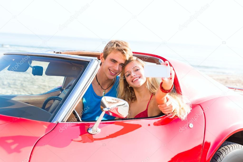 selfie photo of young teen couple in convertible