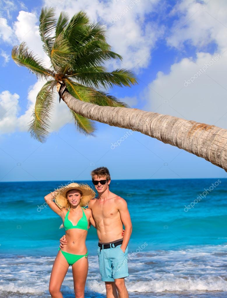 Couple of young tourists in a tropical beach