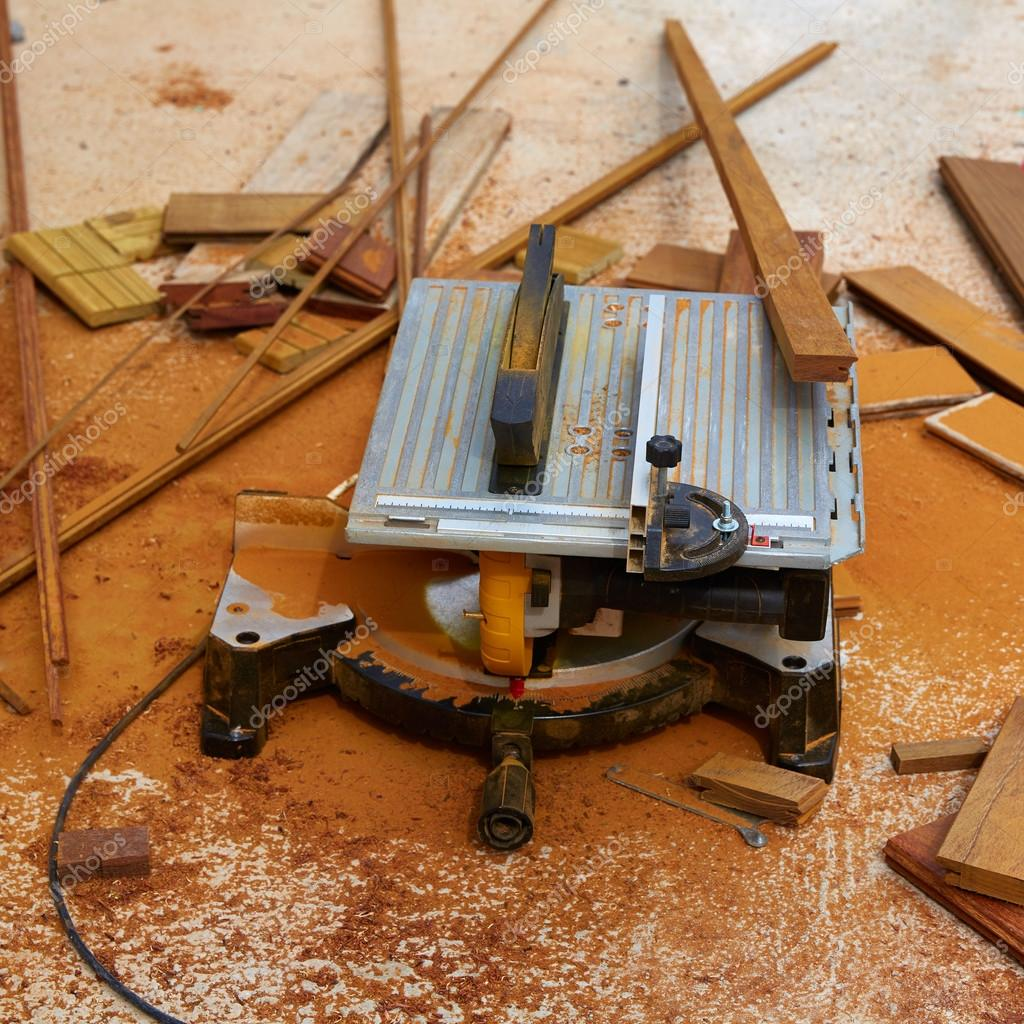 Circular table saw carpenter tool and sawdust