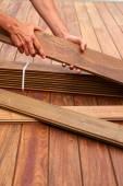 Ipe deck installation carpenter hands holding wood