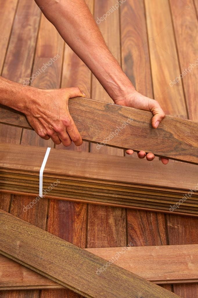 Ipe deck installation carpenter hands holding wood