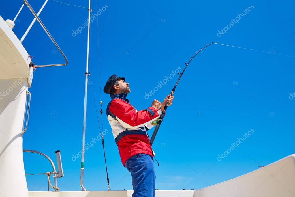 Beard sailor man fishing rod trolling in saltwater