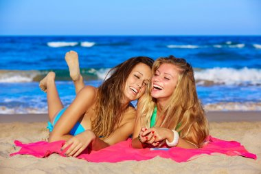 friends girls having fun laughing lying beach sand