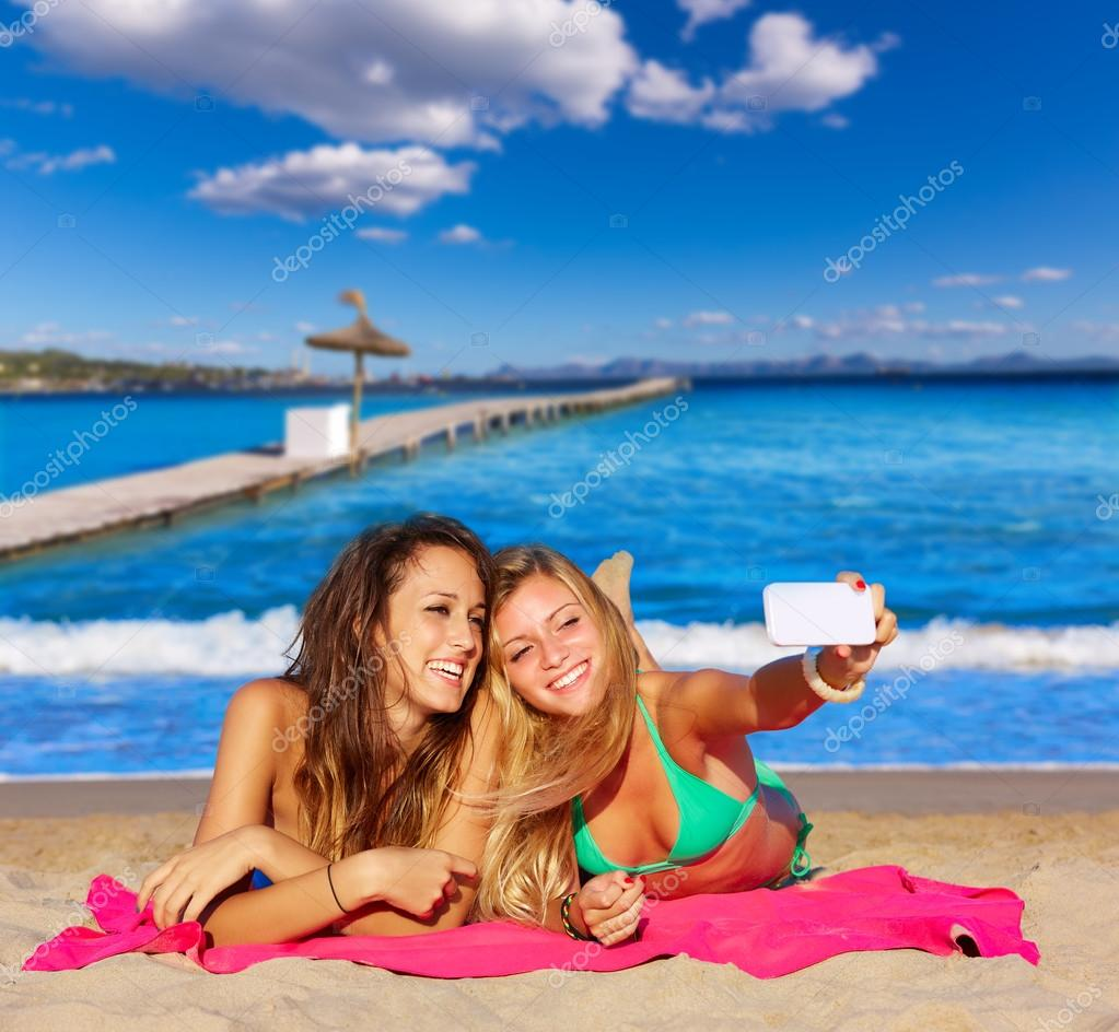 happy girl friends selfie portrait beach sand