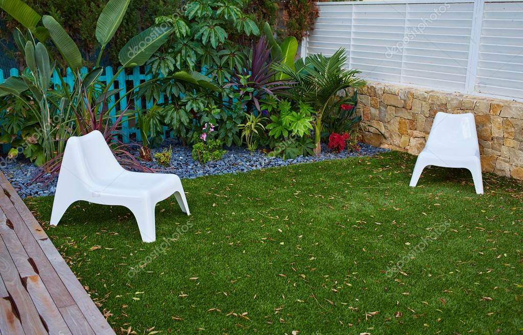 tropical garden with artificial grass turf wood deck