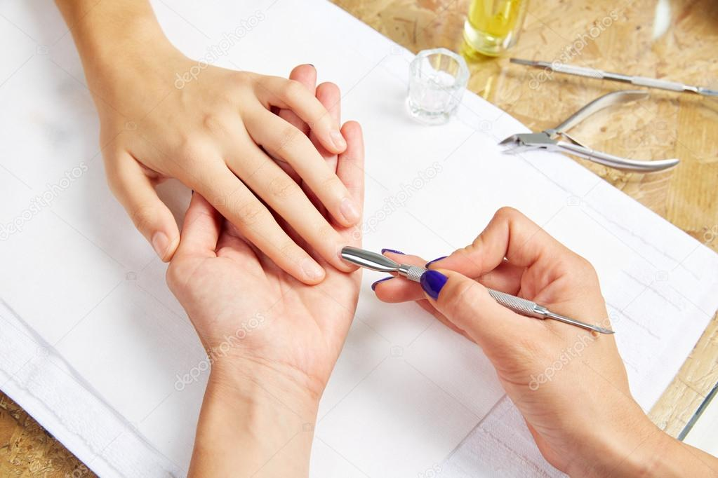 Cuticle pusher tool in nails salon woman hands — Stock Photo ...