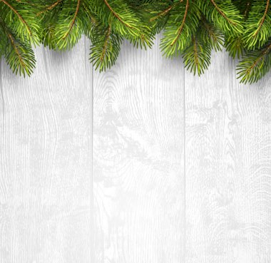 Christmas wooden background with fir branches