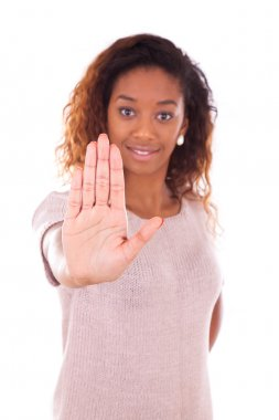 African american making stop sign with her hand palm isolated on