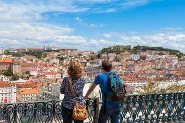 Tourist watching to Lisbon rooftop from Sao Pedro de Alcantara