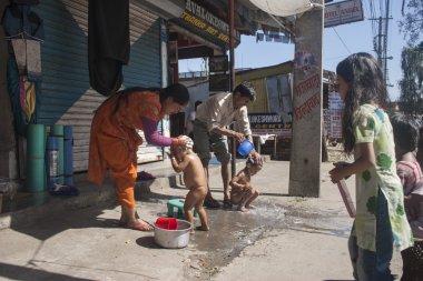 Parents bathing the children