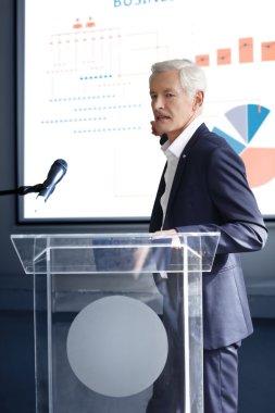 Senior businessman giving a speech