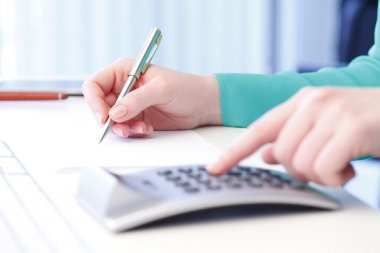 Businesswoman working on financial plan