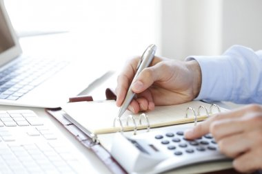 Financial businessman calculating tax expenses