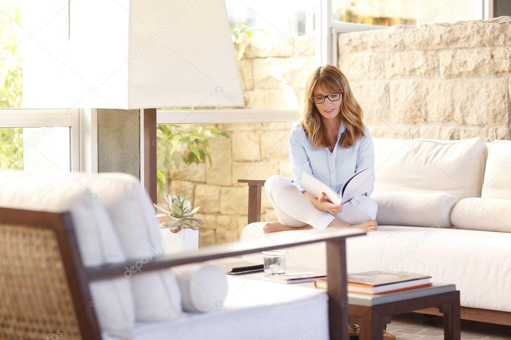 Woman Sitting At Her Luxury Home And Reading. U2014 Stock Photo