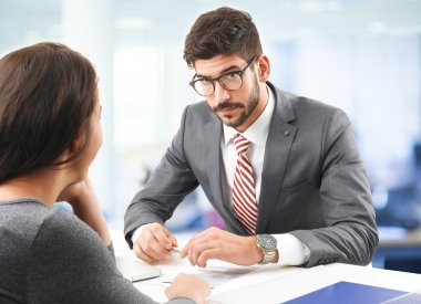 businessman interviewing young woman