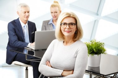 Attractive businesswoman with colegas