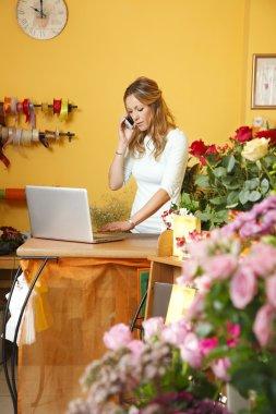 mature florist making call