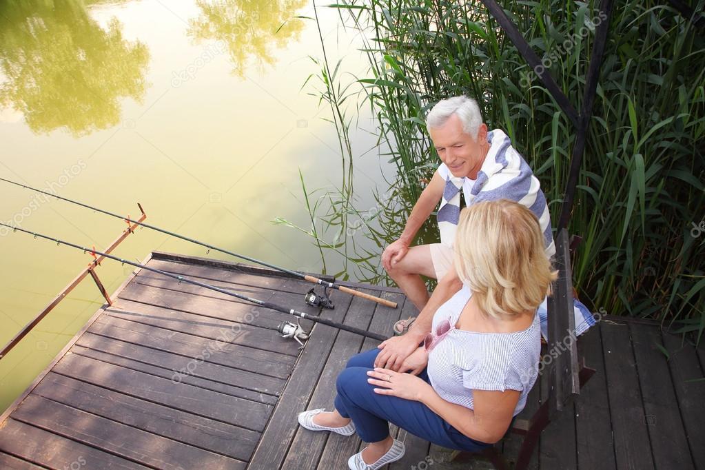 Happy senior couple fishing