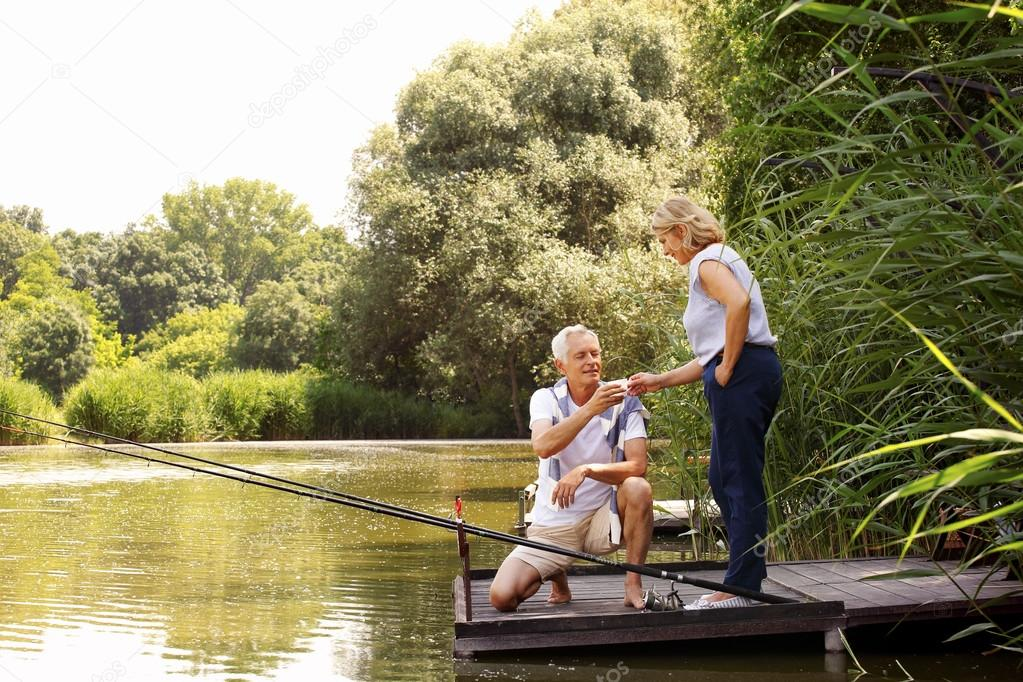 Senior couple relaxing and fishing